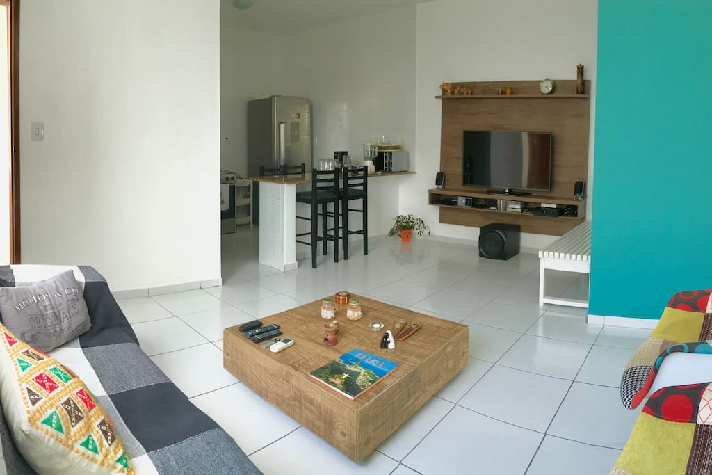 The open living room also with air-conditioning and well equipped digital entertainment system, cable TV, a PS3, reclinable sofa and open kitchen.