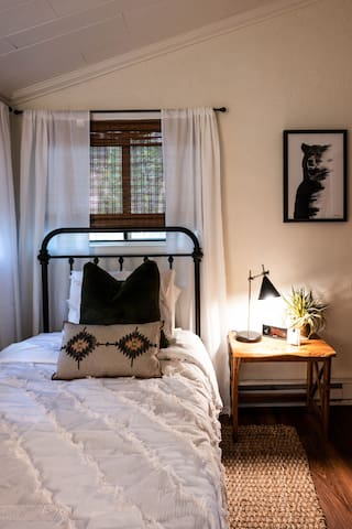 The second bedroom is equipped with a twin bed and new fluffy bedding. All rooms have lamps with USB charging ports as well as the clocks for your convenience.