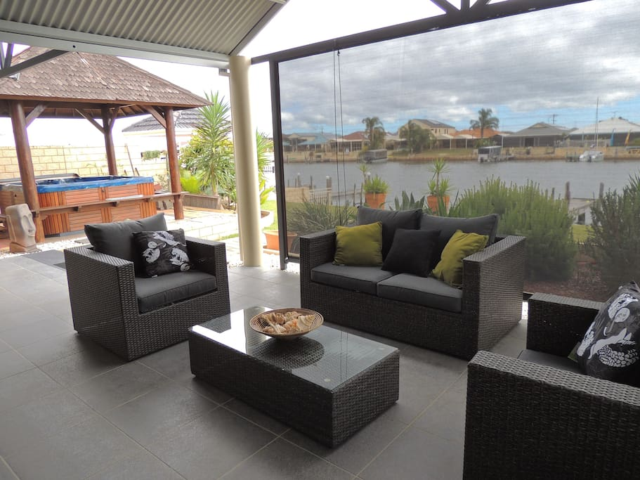Put your feet up or have a read whilst relaxing on outdoor furniture overlooking the canal
