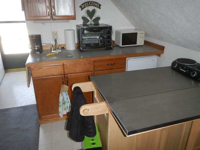 you would generally expect and including a bread machine, bakeware, pyrex,a large portable oven, apt sized frig with small freezer, microwave,crock pot, and a two burner cook top