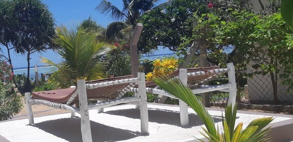Private relaxing garden area for sun bathing facing beach