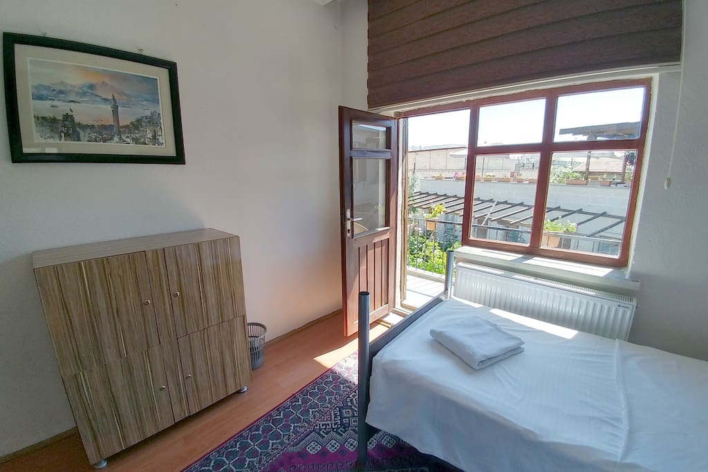 BUDGET DOUBLE/TRIPLE room - sleeps 2-3 persons.  The only room with a balcony!