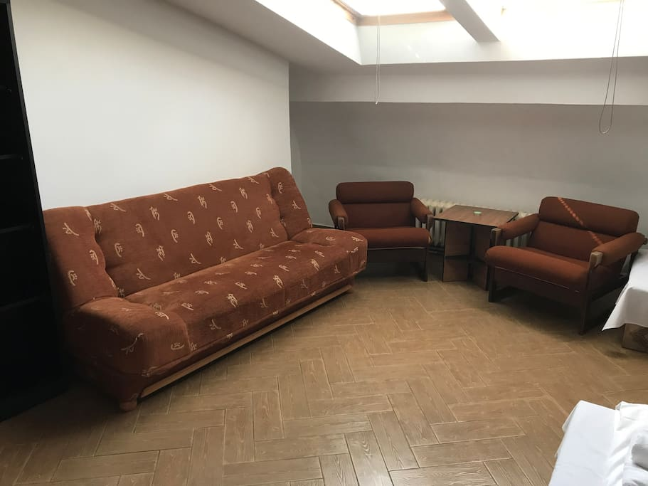 Two single beds, sofa, chairs
