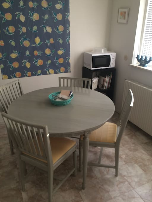 Microwave and table with chairs in the kitchen