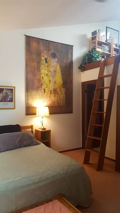 Doorway is to private, in-suite bathroom. Ladder to loft library with host escort only.