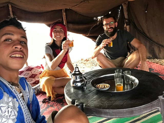 My son rachid with our guests having tea in the nomad family place
