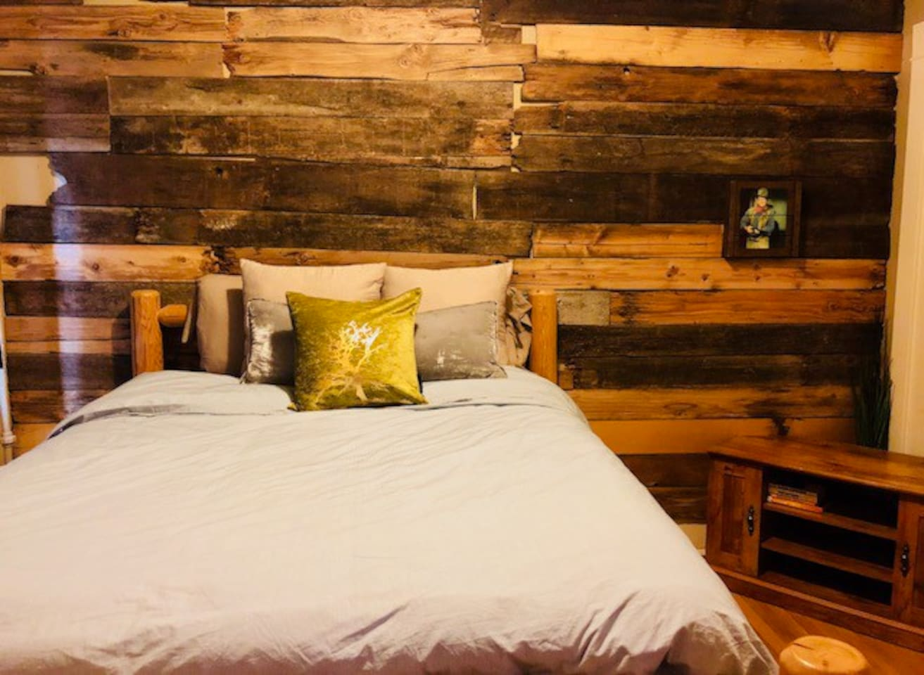 Cozy and comfortable rustic style bedroom with queen sized bed and quality linens