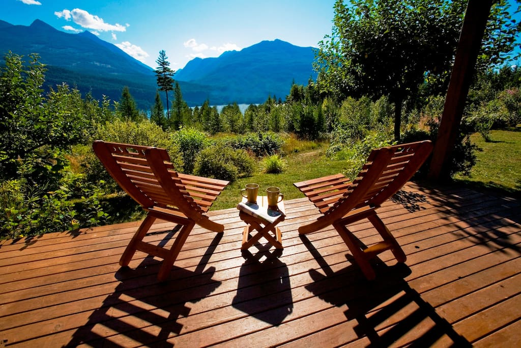 Relax on the deck of your private mountainside cottage nestled within 20 acres of pristine lakefront wilderness