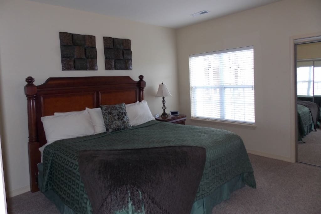 Master Suite with King-Sized Bed, Flat-Screen TV, DVD.