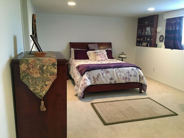 The master bedroom has a queen-size bed.