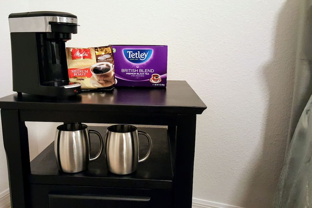 Single serve coffee and tea maker in room.