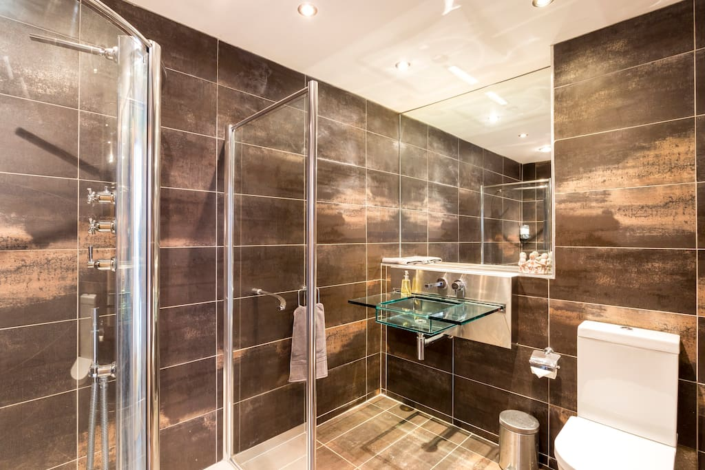Your own Private Bathroom with walk in shower and glass sink.