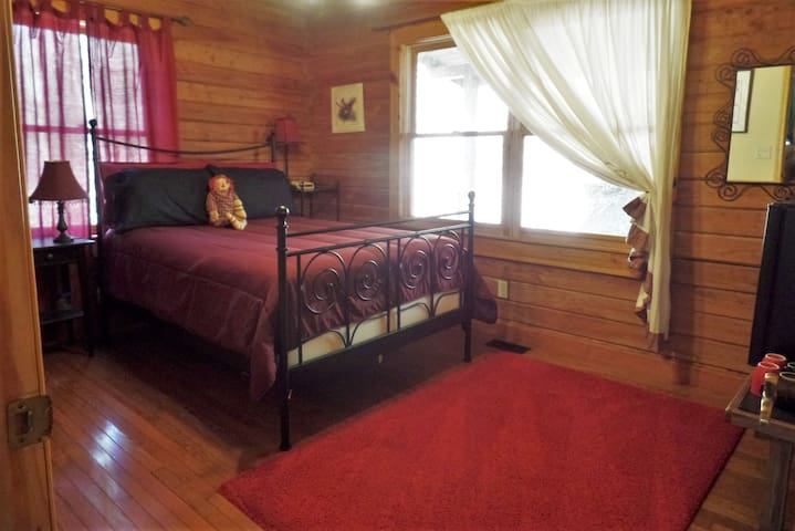 Warm and cozy North Guest Room with large closet & coffee bar.