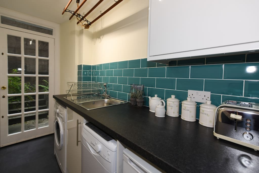Fully equipped kitchen with external door onto rear Courtyard.