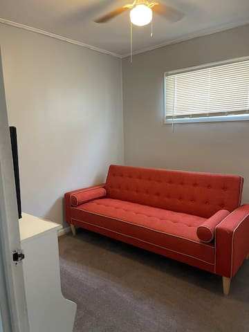 3rd room usually game play or alone time room.. has tv can play games sofa turns to a nice sleeping Futon books games