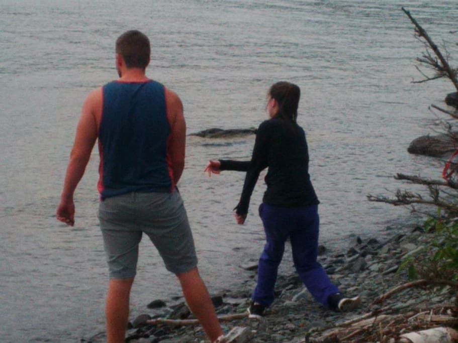 Skipping stones at the pebble beach