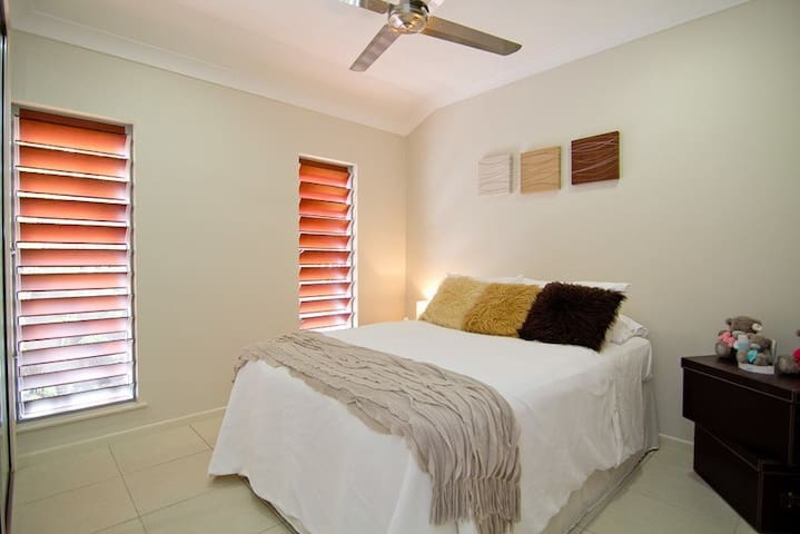 The light-filled third bedroom also comes with a queen-sized bed and ceiling fan to ensure a comfortable night's sleep.