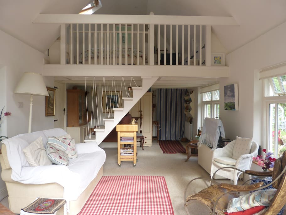 Living area with stairs to mezzanine