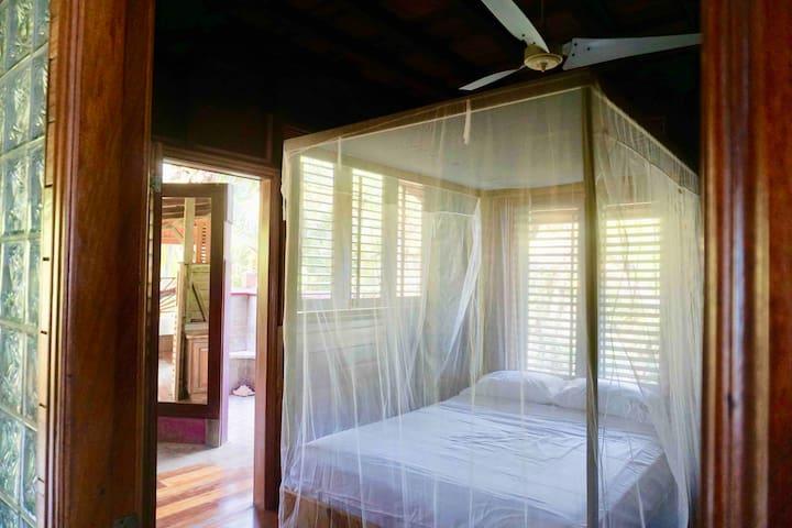 third bedroom - queen bed - lower level with en suite bathroom + outdoor shower