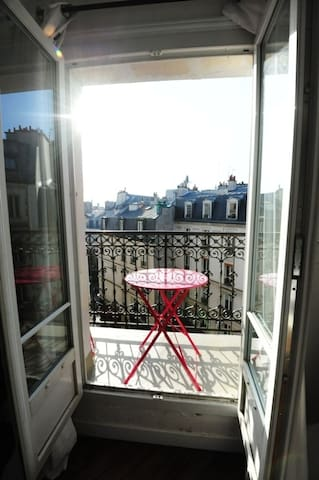 Balcony (which runs all around the apartment); view on Hemingway  house and place contrescarpe