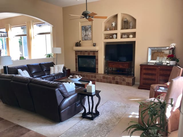 """Family Room Seats 8, with 54"""" Flat screen TV, and Gas Fireplace."""