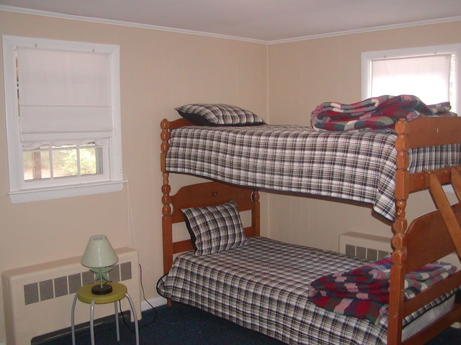 Second bedroom is extra large and features bunks plus twin