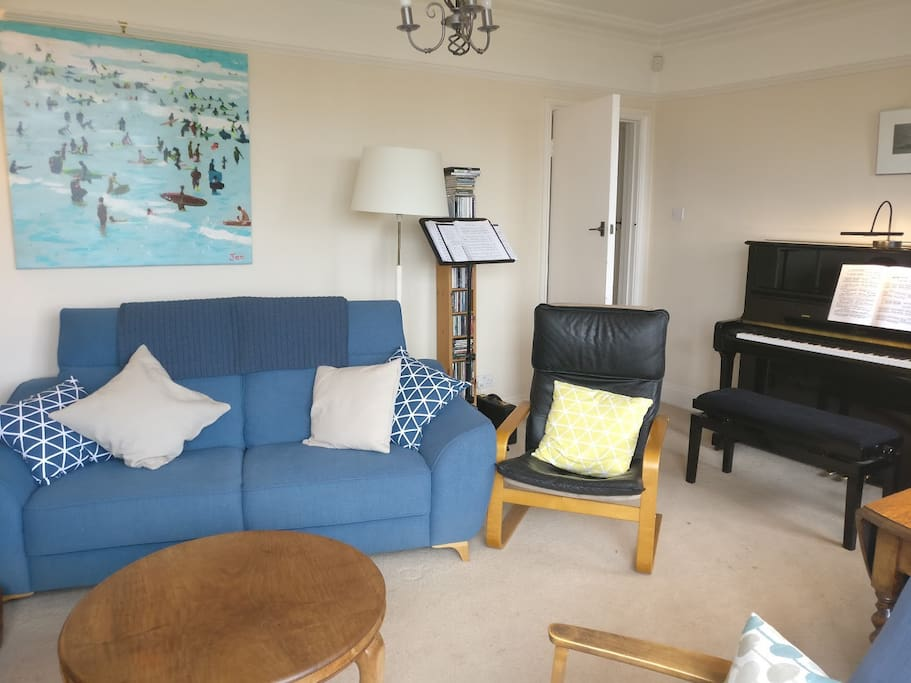 Large lounge with sofa and 3 chairs, TV, fireplace, large table and 3 small tables. We also have a piano which you are welcome to use if you know what you are doing - but please be careful!