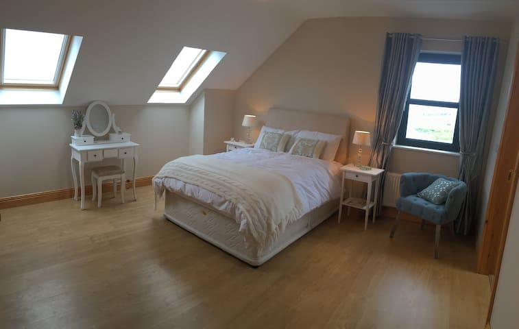 Your double room with stunning ocean views from all windows and a lovely place to relax