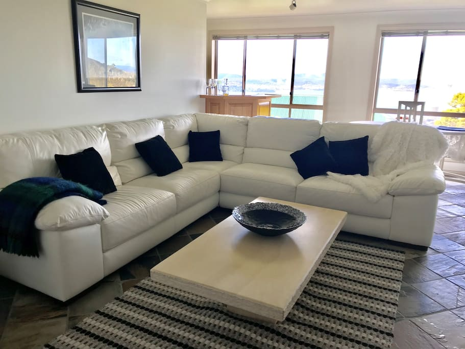 Take your shoes off please, and curl up on this high class white leather lounge.