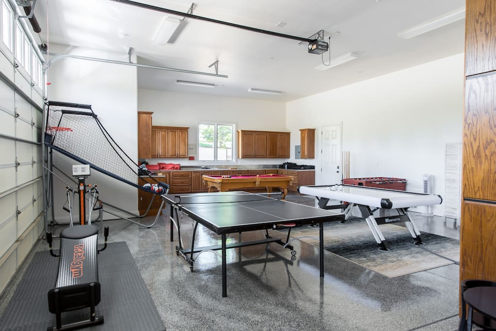 Kids will appreciate that the converted garage has a giant game room.