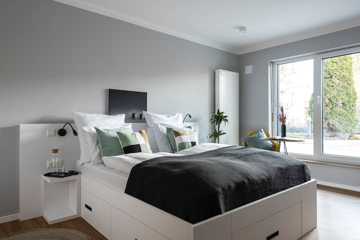 Carefully designed bedroom with a king-sized bed