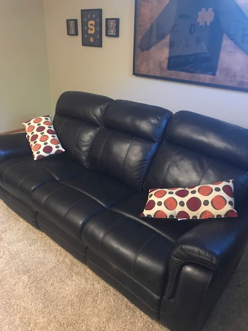 Couch in living area suitable for sleeping
