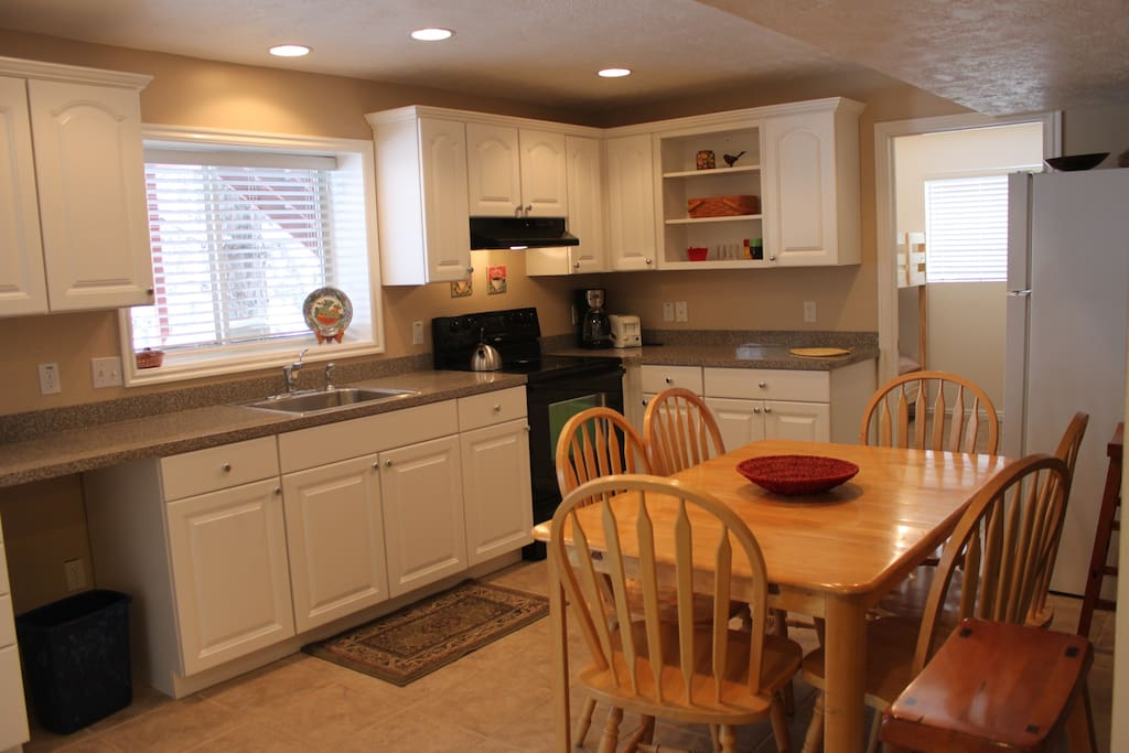 Spacious kitchen area with full fridge and oven/range.