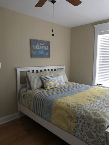 Queen bed with 32 inch flat screen tv with Blue Ray DVD player and ceiling fan.