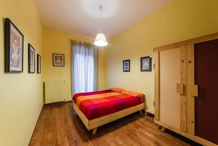 Yellow room with king size bed