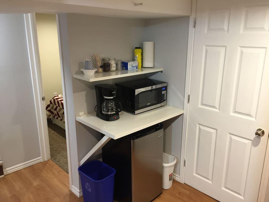 Microwave, mini fridge, and coffee machine. Free coffee, sugar and whitener.