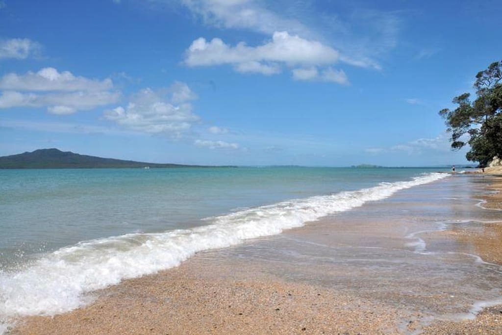 Takapuna Beach, boasting golden sand, overhanging Pohutakawa trees and surf at odd times, take the kayaks down the beach and have a blast!