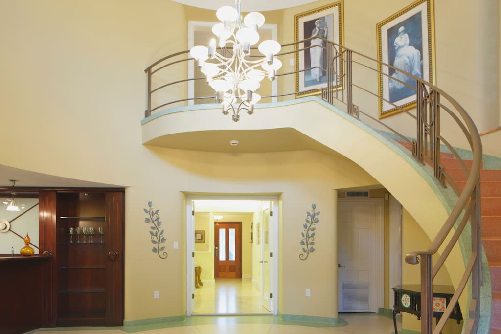 Elegant staircase to rooms, original built in 1949 mid-century modern style.