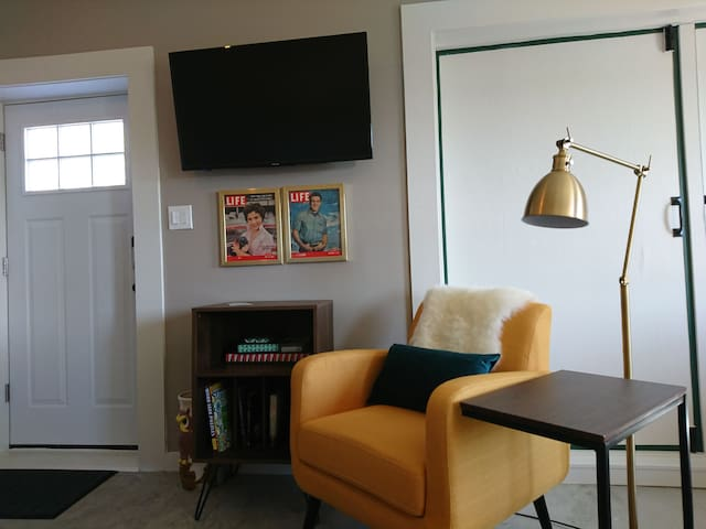 Entrance door into living room area. The TV you can view from the living room or kitchen.