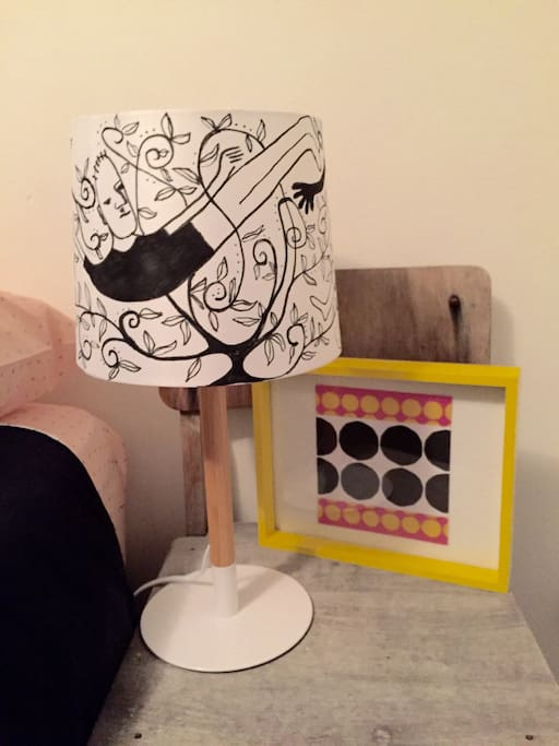 Hand painted lamp shade in bedroom