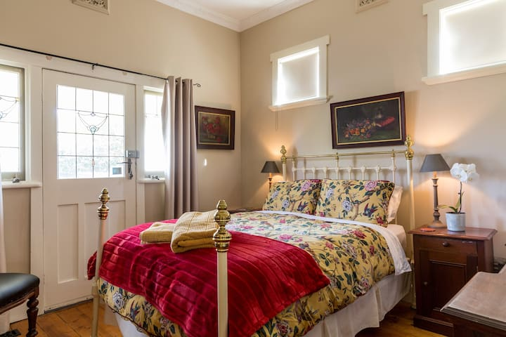 Very comfortable bed with historic furnishings and private front verandah entry