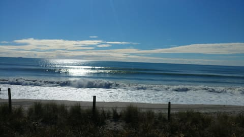 Classic 80s beach front kiwi bach