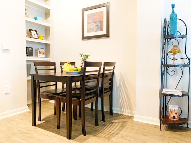 Dining Area - New dining table and chairs with seating arrangements that accommodate up to 4 people.