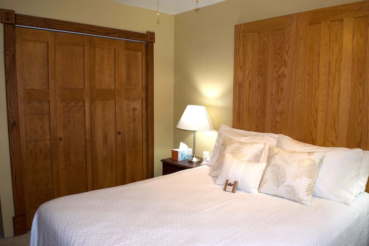 The bed is comfortable and cozy. Bifold doors form the headboard. A full closet is in the room.