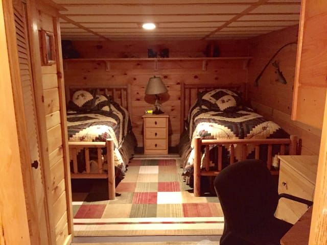 Downstairs/basement bedroom.  Please note: this room is small and is located in the basement away from master bedroom.