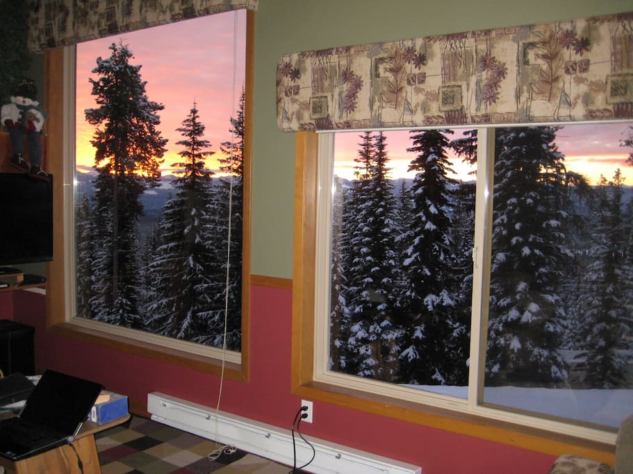Watch the sun come up through huge picture windows