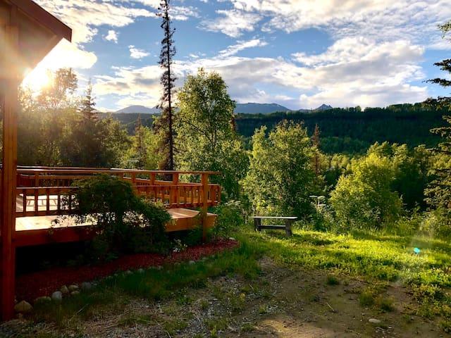 """Alaskan lake side cabin"""