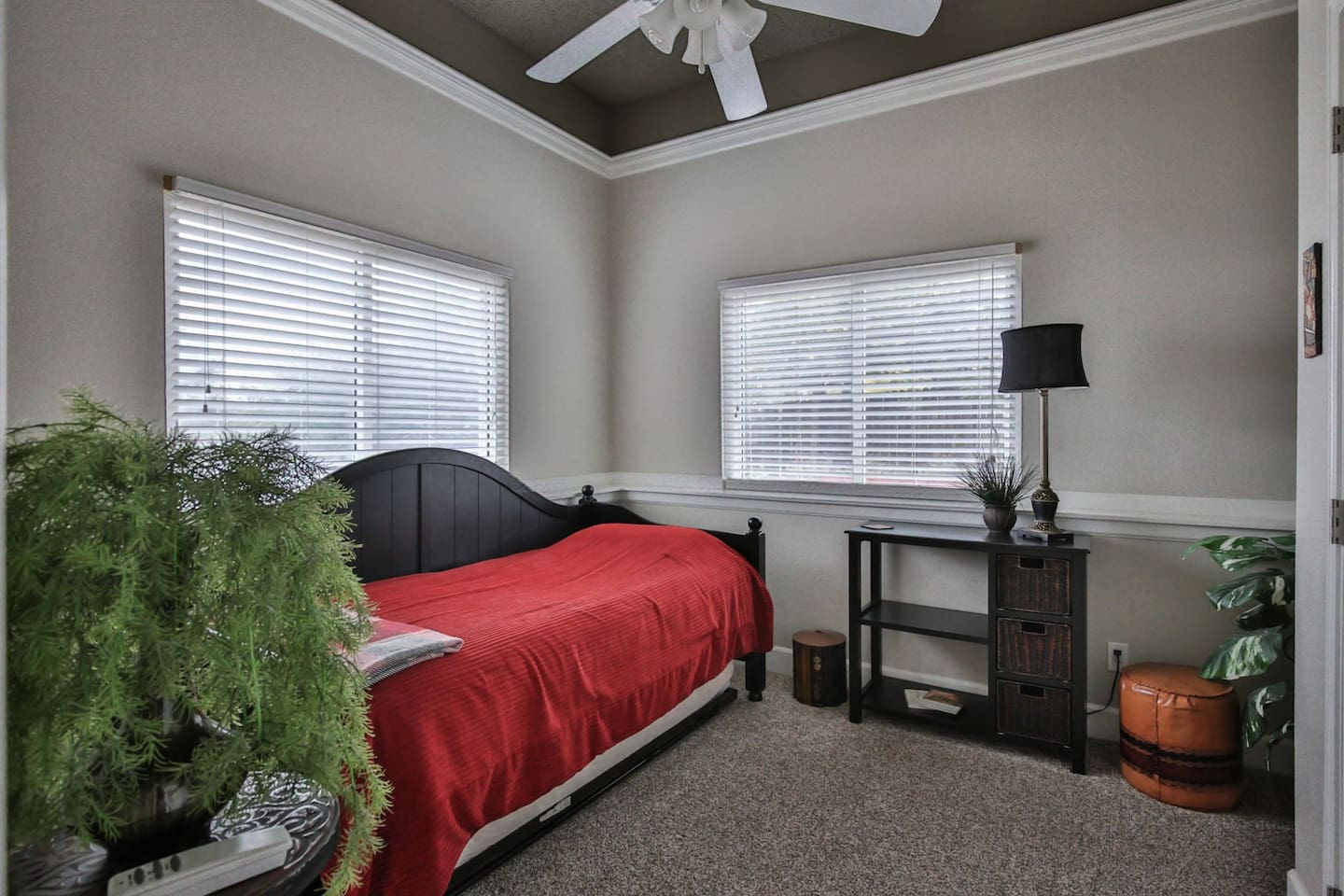This is your sunny, cozy room with a pull-out trundle bed. This room is on the lower level of our house and directly adjoins the family room.