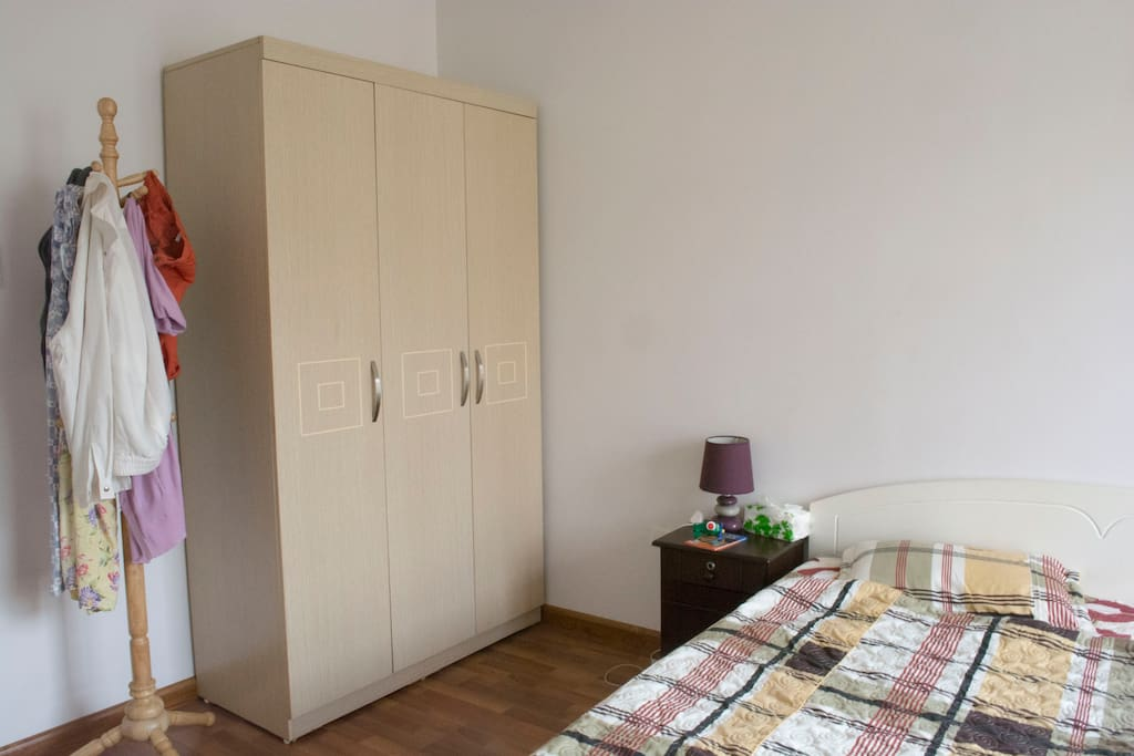 The master bedroom is equipped with a coat hanger stand and a wardrobe with a safe inside.