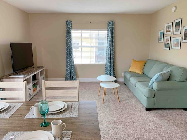 """Living room with 55"""" Smart TV and a queen pull out sofa sleeper"""